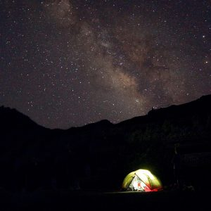 Tent at night with stars